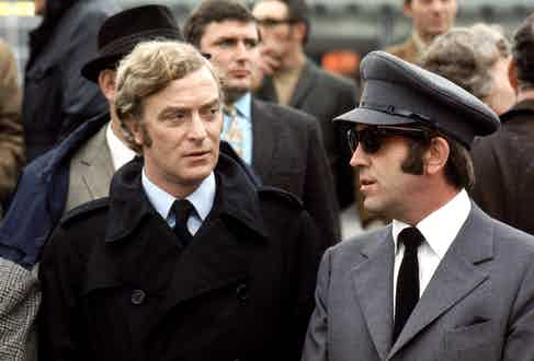 On set with fellow English actor Ian Hendry as gangster chauffeur Eric Paice, 1971.