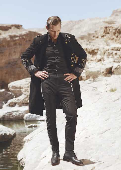 Robertas Aukstuolis wears black wool and velvet military coat, cotton shirt and wool military pants, all Dolce & Gabbana; black leather and navy suede boots, Christian Louboutin. Originally published in Issue 53 of The Rake.