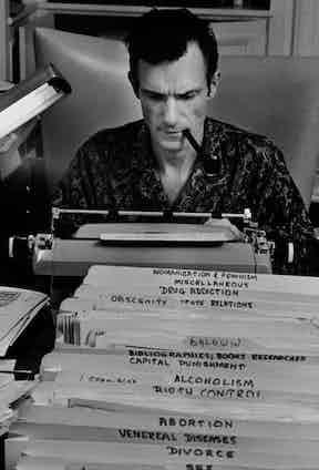 Hugh Hefner, Playboy founder, typing at his desk in his mansion in Las Vegas, 1966.