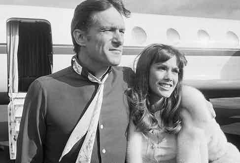 Hefner with one of his many girlfriends Barbi Benton at Paris airport, 1969.