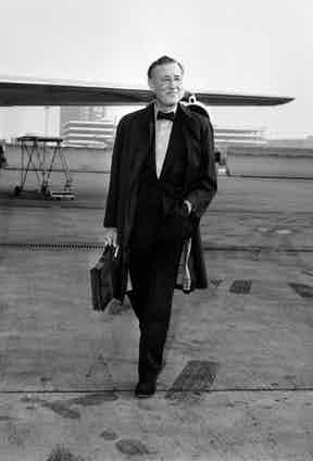 Strolling in off the air field in January 1964, returning from the solace of his Jamaica home which he loved to visit and where he wrote most of his novels.