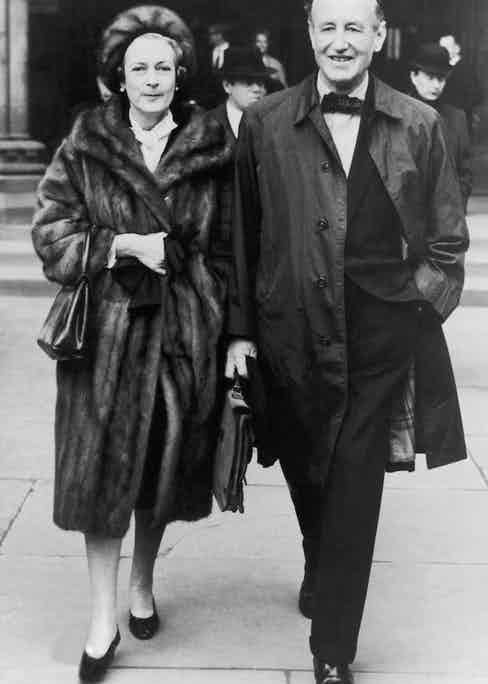 Photographed here with his wife Ann Charteris, a countess who he married after their well publicised affair. This photograph was taken in November 1963, the year before his death.