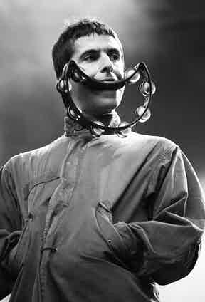 Performing in a parka with a mod-like haircut and tambourine.