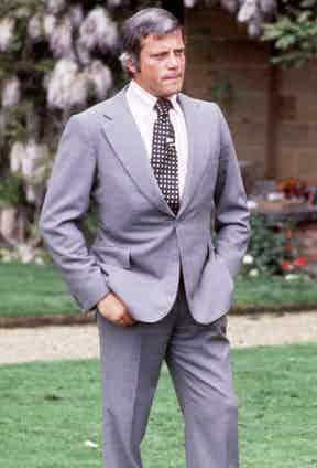 Reed wears a grey single-breasted suit with spotted tie and tie pin in the TV programme Today, 1977. Photograph by FremantleMedia Ltd/REX/Shutterstock.
