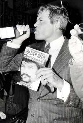Reed at the launch of his book, 'Reed All About Me', with his staple drink in hand, 1979. Photograph by Bill Cross/Daily Mail/REX/Shutterstock.