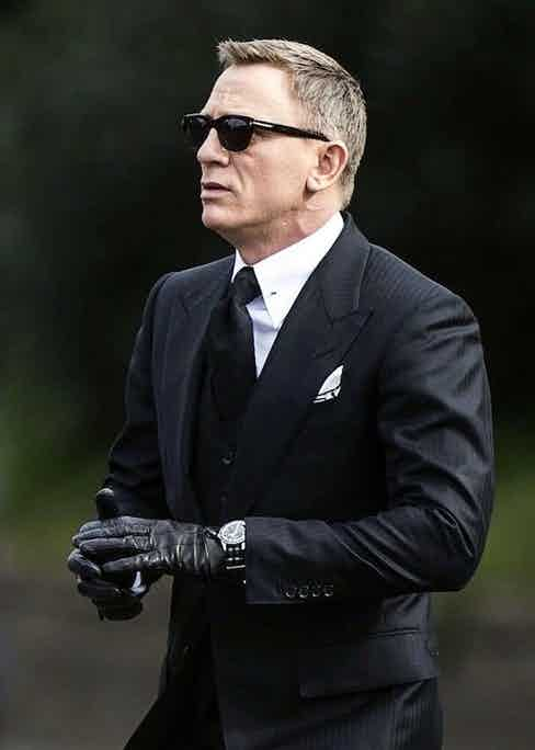 Daniel Craig wears the Omega Seamaster 300 SPECTRE Limited Edition with rare lollipop seconds hand and black and grey NATO strap.