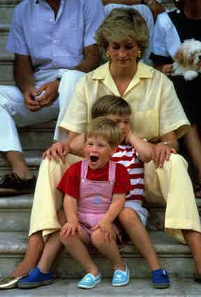 Always ahead of her time, Diana is seen here in a linen pale yellow jumpsuit on holiday in Spain with William and Harry, 1987.
