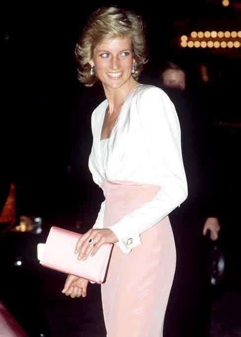 The princess in what would become one of her most famous dresses by Catherine Walker, worn here at The Coliseum attending the ballet 'Swan Lake', 1989. Walker dressed Diana on a number of occasions.