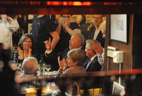 Bo Dietl (seated, center) holds court this week at his table at Rao's, which he's had every Thursday since 1977. Photo by Christopher Sadowski.