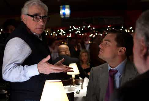 Martin Scorsese directs Leonardo Di Caprio and Bo Dietl during the making of Wolf of Wall Street, 2012.