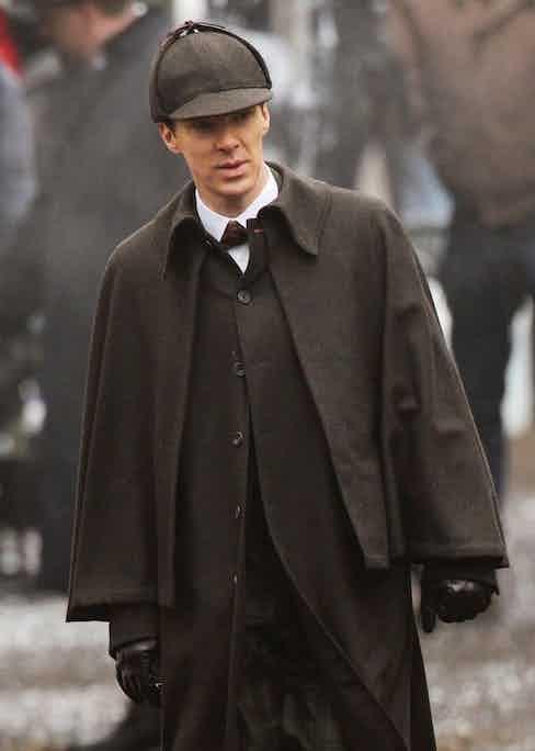 Cumberbatch in period dress - including a cape and deerstalker hat - filming an episode of Sherlock set in Victorian London.