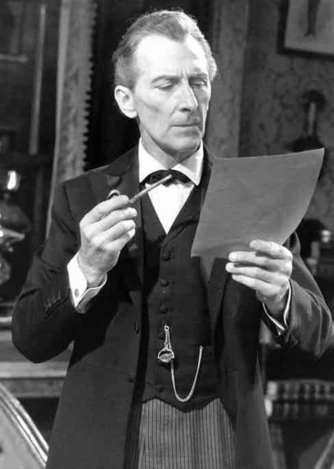 Peter Cushing in the 1968 series of Sherlock Holmes, smoking a pipe while reading. Sherlock's style over the years has paralleled the decline of formal dress, as seen here; Cushing wears double-cuffs, a waistcoat and a pocket watch.