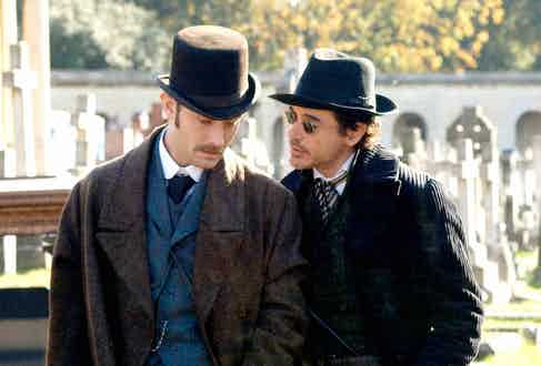 Jude Law and Robert Downey Jr wear heavy overcoats, three-piece suits and hats in the mystery period action film Sherlock Holmes, 2009.