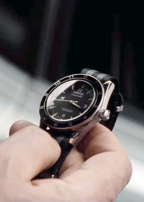 """The NATO strap is reminiscent of Connery's Submariner in Goldfinger. """"What does it do?"""" Bond asks Q in Spectre. """"It tells the time,"""" he replies dryly."""