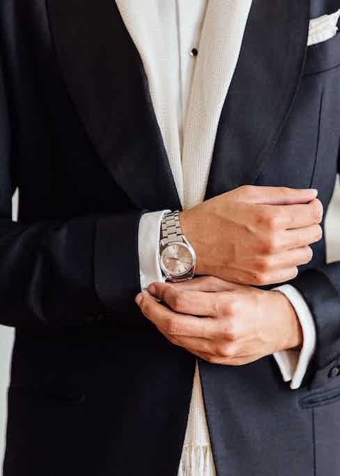 Jonathan Alexander Edwards wears a black three-piece dinner suit by Neapolitan tailors Solito complete with turn-back cuffs, a double cuff dress shirt and an Omega Seamaster wristwatch. He displays here the correct amount of shirt to show for formal dress. Photograph by Jamie Ferguson.