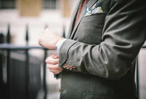 Simon Crompton demonstrates how to wear a gauntlet cuff with four buttons on the sleeve, here rendered in a bespoke green flannel suit by Anderson & Sheppard-trained tailor Brian Smith.