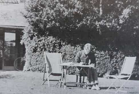 "Rupert Brooke perhaps creating a masterpiece in the comfort of a sunny garden. Aside from his writing, he was also described as ""the handsomest young man in England"" by W. B. Yeats."