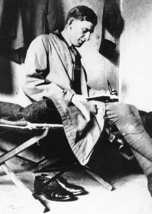 Siegfried Sassoon, celebrated English poet and novelist on his campbed during World War One.