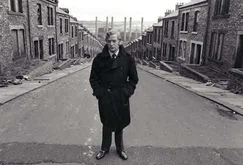 Caine wears his double-breasted trench coat with the collar turned up, re-enforcing his character's rebellion against complicity on the streets of Newcastle, 1971. Photograph by MGM/Kobal/REX/Shutterstock.