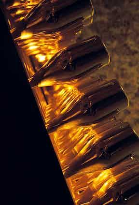Bottles of Armand de Brignac Gold Brut ageing on riddling racks.