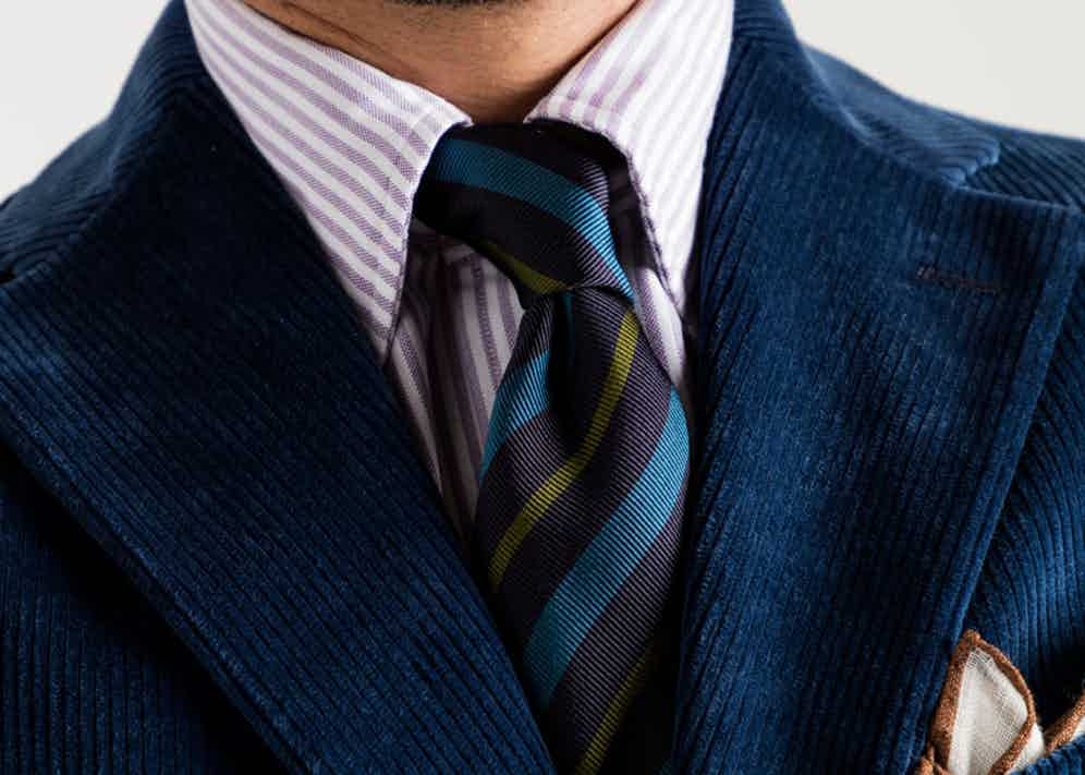 Navy cotton corduroy single-breasted jacket, lilac Bengal stripe Oxford cloth shirt and navy, teal and olive reppe stripe tie, Drake's for The Rake.