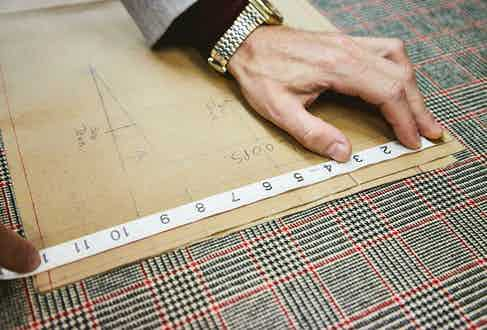 The material has a distinct Prince of Wales check.