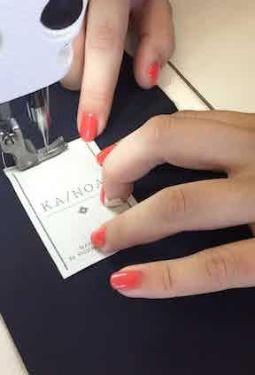 Putting the final touches on a KA/NOA garment.