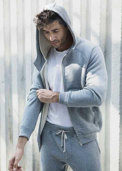 KA/NOA's melange fleece zip-up hoodie and jogging trousers.