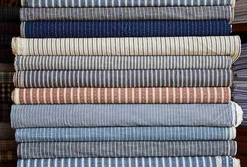 Bolts of cloth ready to be cut into patterns.