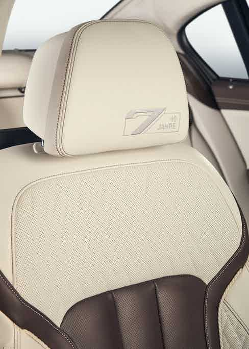 Subtle details include contrast stitching throughout the leather interior, as well as a hand-stitched logo on the headrests. Photograph by Jake Walters.