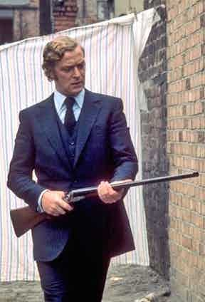 The silhouette of the three-piece is what gives Caine's actually fairly ordinary physique a measure of Olympian robustness.