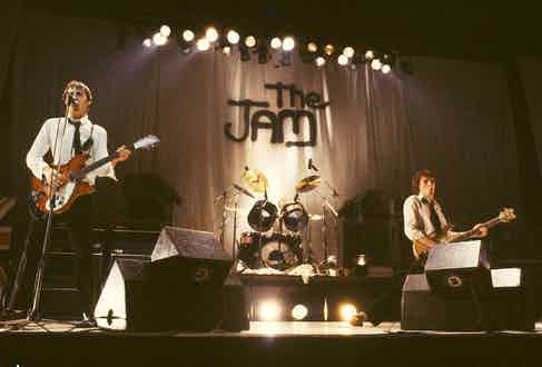 The Jam performing at the Hammersmith Odeon, circa 1970s. (Photo by Steve Morley/Redferns).