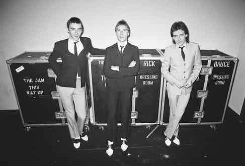 Guarding their wardrobe flight cases backstage in 1979.