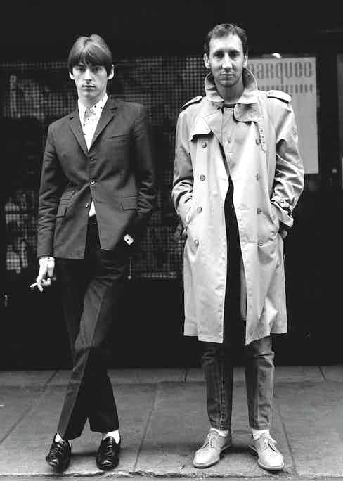 Weller wearing one of his signature mod-style suits with Pete Townshend of the Who in Soho, London in 1980.