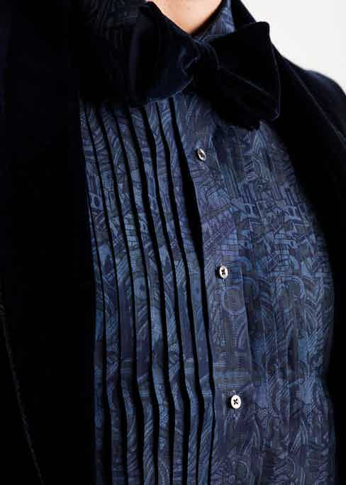 The dinner shirt features pleats at the front.
