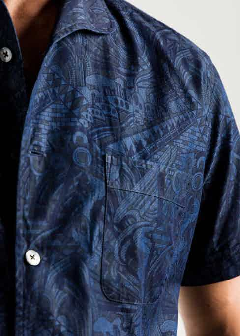 The short-sleeve shirt features a front patch pocket and once-piece collar.