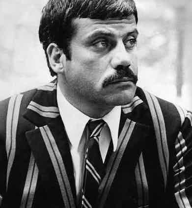 Oliver Reed in bold striped tailoring filming the Women in Love, 1970.