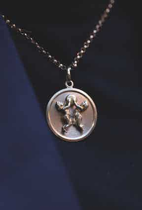 """The necklace reflects a superstitious side to Daisy, as the delicate medallion depicts the zodiac sign of Gemini. """"So many people I love are Gemini. I'm secretly obsessed with astrology."""""""