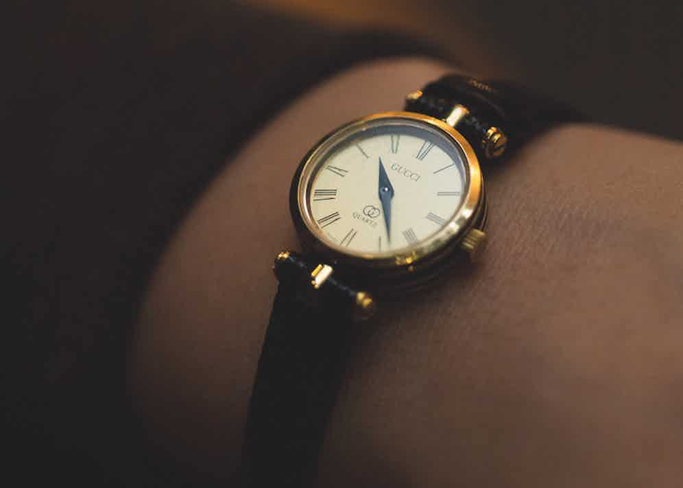 """Daisy describes her vintage Gucci watch with a narrow leather strap as """"elegant and poised"""", just like her grandmother, from whom she inherited it."""