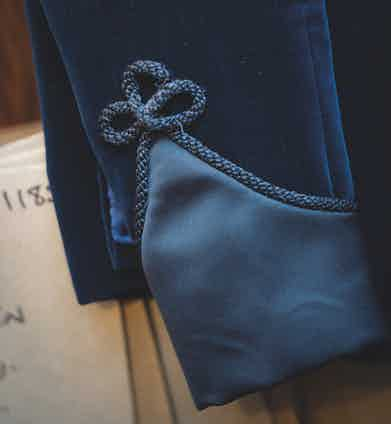 """""""This is the first real piece of Huntsman tailoring I fell in love with,"""" Daisy says of the dark blue velvet smoking jacket with black military frogging and silk details. """"It's beautiful, so I wear it as much as possible."""""""