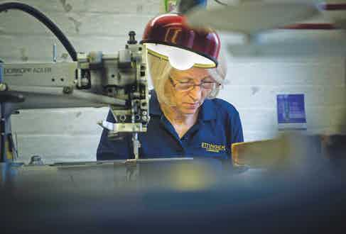 One of Ettinger's many skilled craftspeople working on a bespoke item.