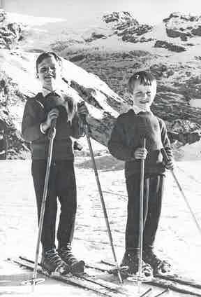 Robert, aged 7, with his younger brother enjoying a skiing holiday in Switzerland.