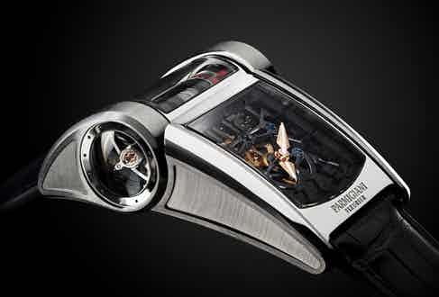 The watch's tourbillon is visible through a circular window on the side of the case.
