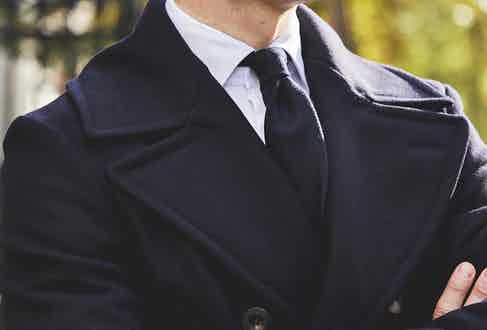 The pea coat's generous lapels and strong shoulders make for a commanding wear.