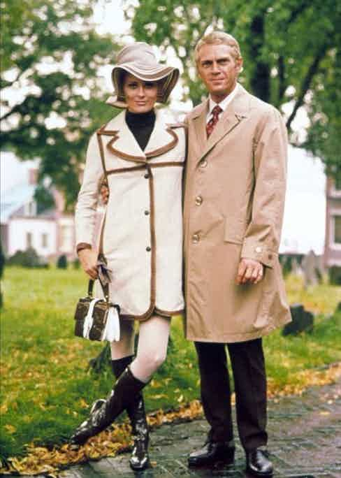 Steve McQueen wears a camel single-breasted raincoat with Faye Dunaway on the set of The Thomas Crown Affair, 1968.