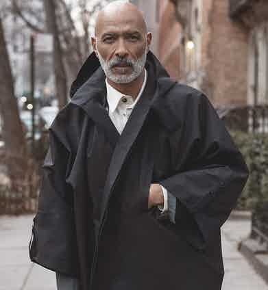 Model wears black eco polyester and viscose Raincho coat, Norwegian Rain; ecru cotton safari shirt, Private White V.C. Originally published in Issue 51 of The Rake. Photograph by Christopher Ferguson.