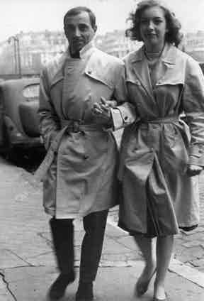 Charles Aznavour and Marie Dubois wear matching belted trench coats on the set of Tires Sur Le Pianiste (Shoot the Piano Player), France 1959.