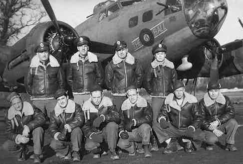 """A B-17 WWII Bomber, """"The 8 Ball"""" and its full crew, all wearing the military legend B-3 sheepskin bomber jacket, circa 1939."""
