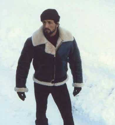 Sylvester Stallone wears a leather and shearling bomber jacket as heavyweight champion Rocky Balboa in Rocky IV, 1985.