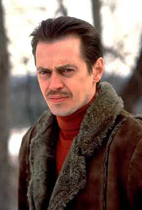 Channel Steve Buscemi as Carl Showalter in Fargo (1996) by pairing a dark brown shearling jacket with a deep red ribbed knit.